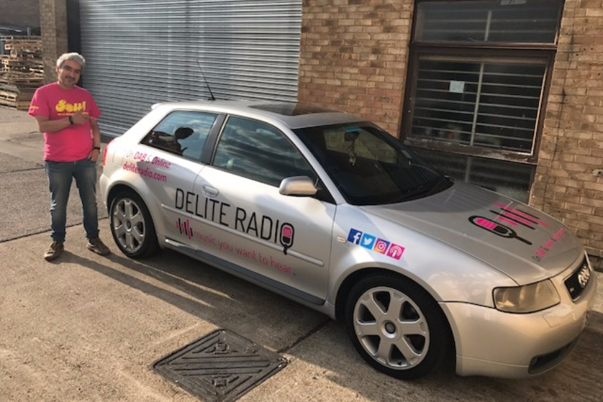 DELITE RADIO CAR ON THE ROAD